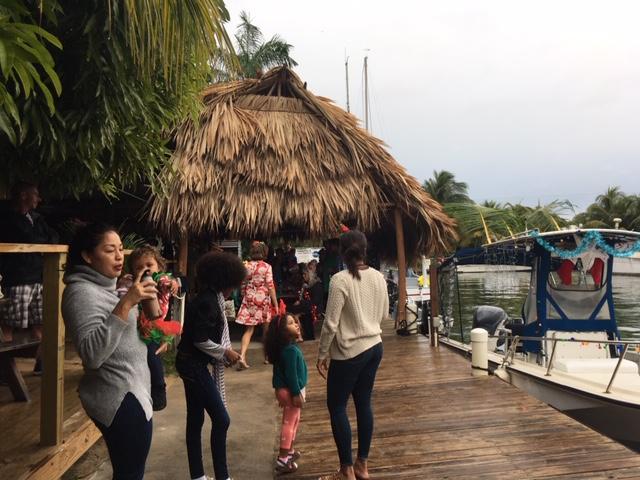 people gathered at Buba Wuba bar in Placencia awaiting the start of the holiday boat parade