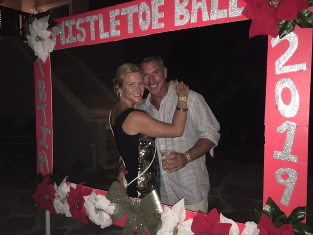 happy revelers posing for photo at BTIA's Mistletoe Ball