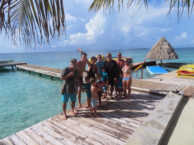 day trippers on King Lewey Island dock over crystal clear carribean water