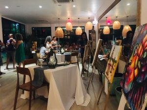 art auction fundraiser at Muna rooftop bar