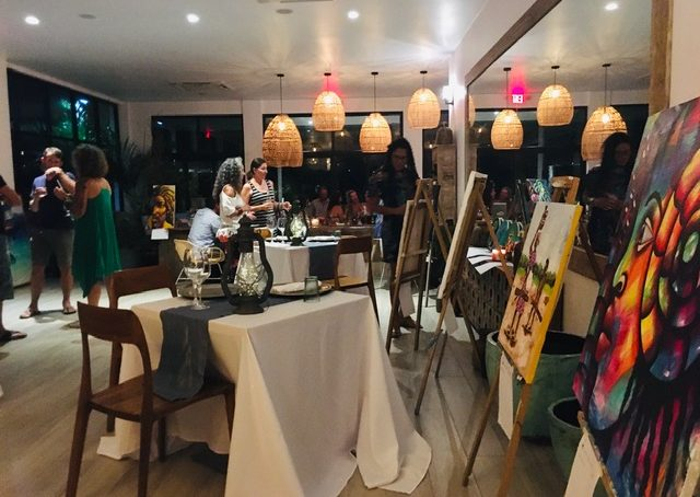 art auction fundraiser at Muna rooftop bar