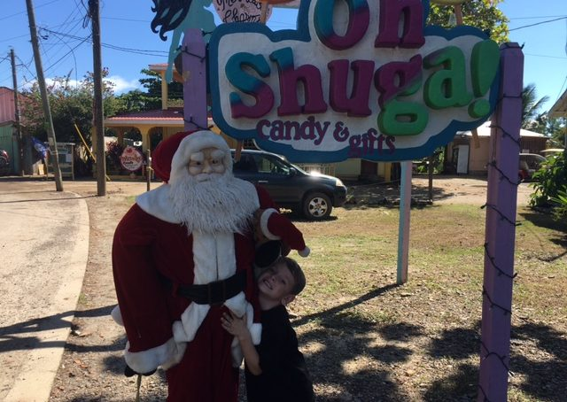 mitch and santa outside of Placencia's candy shop