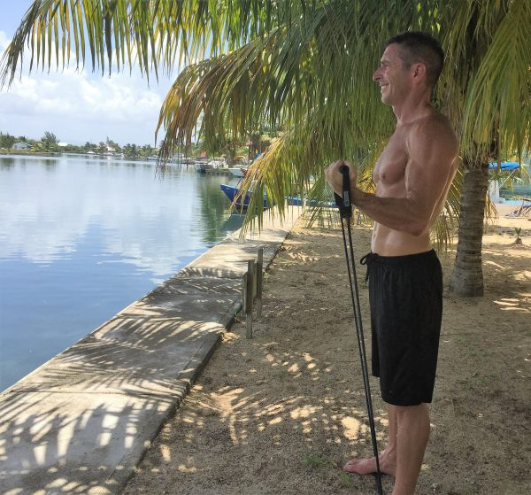 Home exercise rouitne, Phil doing curls on the Placencia lagoon- Real Life Recess