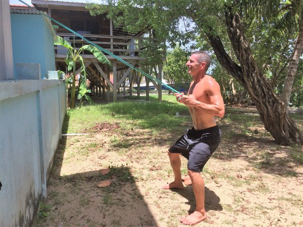 Home exercise routine, Phil rowing on Placencia Lagoon- Real Life Recess